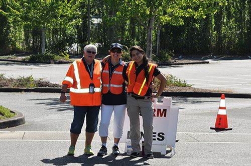 Three ladies from the BPD volunteer corps helping at shredding event.
