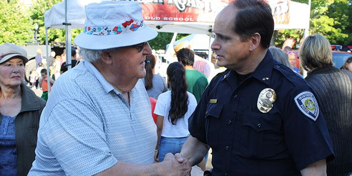 BPD Chief Monger greets resident at community event