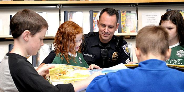 Beaverton police officer visits with children at the library